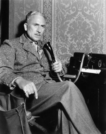 Man talking on an old fashioned telephone