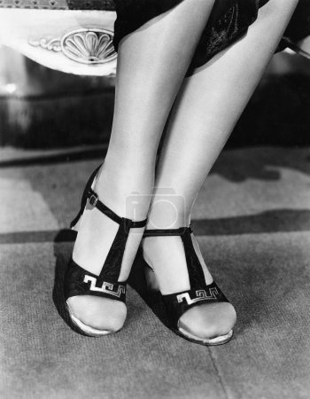 Low section view of a woman wearing sandals