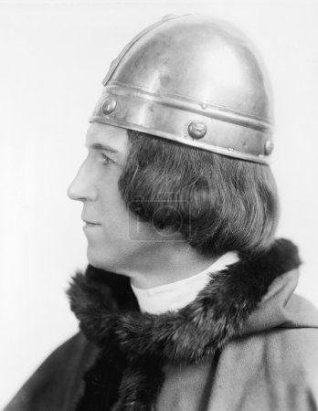 Portrait of a man in costume and a helmet looking away