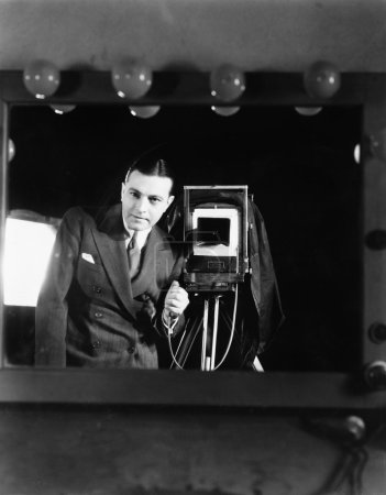 Portrait of a man standing with a large format camera
