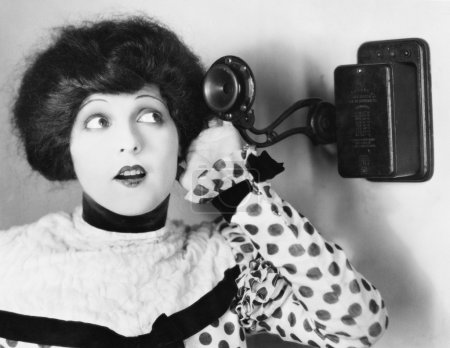 Portrait of a young woman talking on the telephone