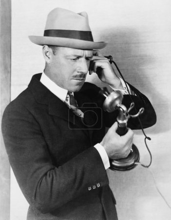 Profile of a man talking on the telephone