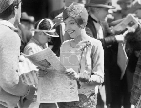 Elegant woman reading a newspaper