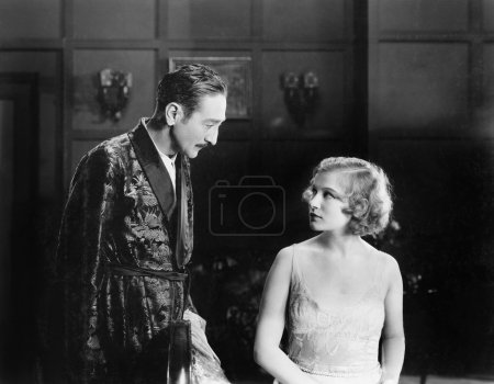 Woman looking unhappy at a man in a robe