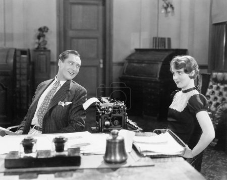 Man and woman in an office flirting with each other
