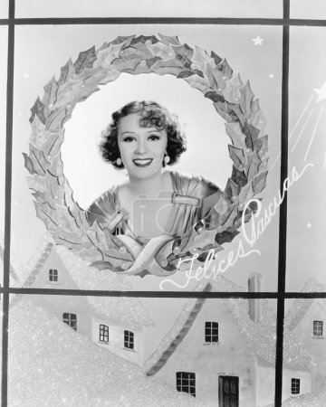 Image of a woman in a holiday wreath