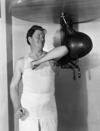 Athlete working out with a punching bag