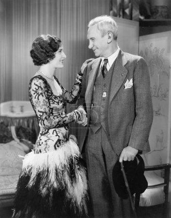 Woman greeting an older man