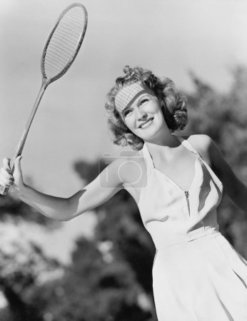 Photo for Young woman with a badminton racket - Royalty Free Image