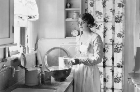 Young woman in her kitchen, baking