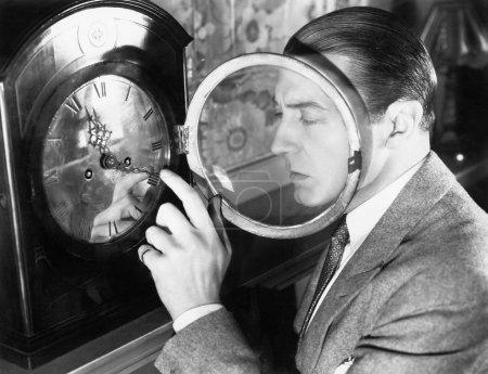 Man setting a clock