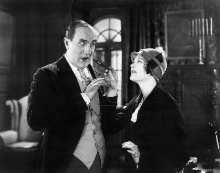 Woman giving a man a cigar