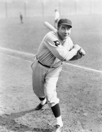 Baseball player swinging the bat