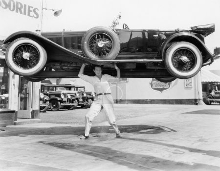 Strong man lifting a car over his head...