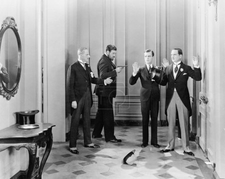 Well dressed men being held up with guns by two other men