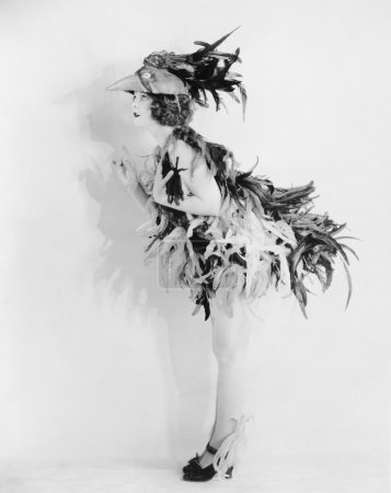 Young woman dressed like a bird is all feathered up and no place to go