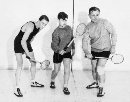 Photo pour Trois hommes jouer au squash - image libre de droit