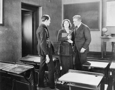 Young woman performing for two men in a class room