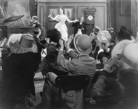 Young woman performing for a group of spectators
