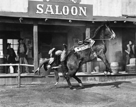 Cowboy being thrown off his horse