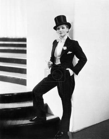 Woman wearing a formal men's tuxedo