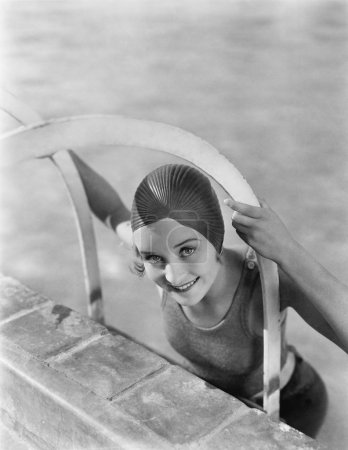 Woman climbing out of a pool