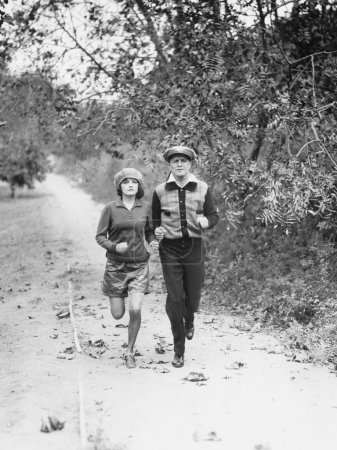 Couple jogging through the country side
