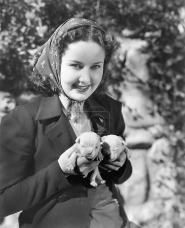 Woman holding two English Bull Terrier puppies