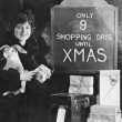 Woman with gifts and sign with number of shopping ...