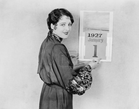 Woman with calendar on New Years Day