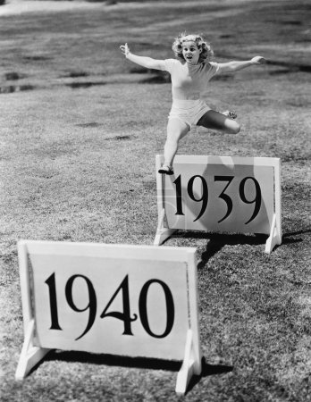 Photo for Woman jumping hurdles labeled with years - Royalty Free Image