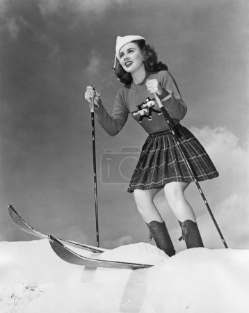 Low angle view of young woman skiing