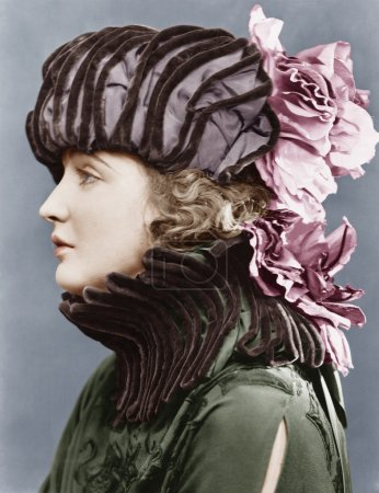 Photo for Woman wearing elaborate hat - Royalty Free Image