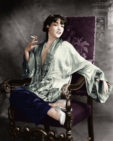 Portrait of a young woman smoking a cigarette and smiling