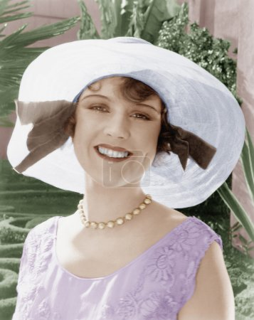 Woman in a wide brimmed hat smiling