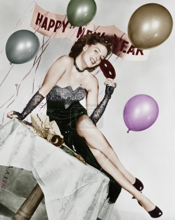 Photo for Young woman sitting on a table with balloons and sign - Royalty Free Image