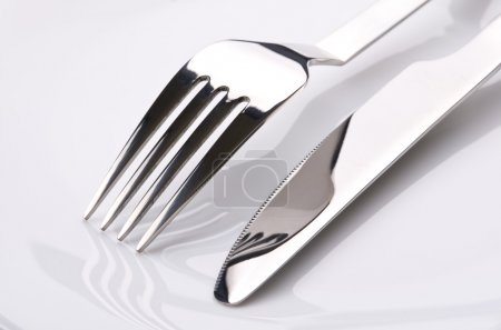 Photo for Fork and knife over white background - Royalty Free Image