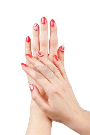 Photo pour Mains de femme avec manucure rouge isolée sur blanc - image libre de droit